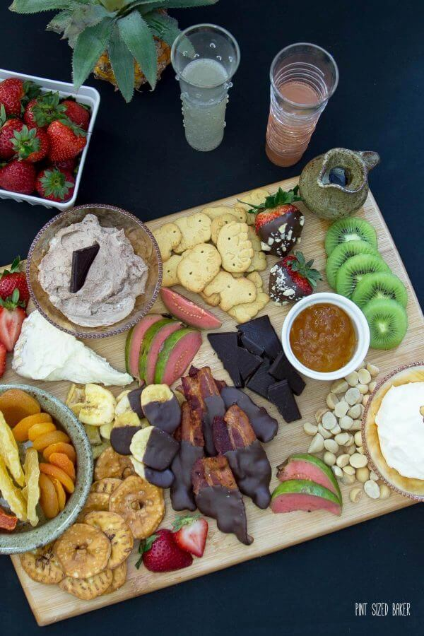 Add a little bit of everything to this dessert charcuterie plate. A mix of cookies, fruit, nuts, chocolate and cheese. Perfect!