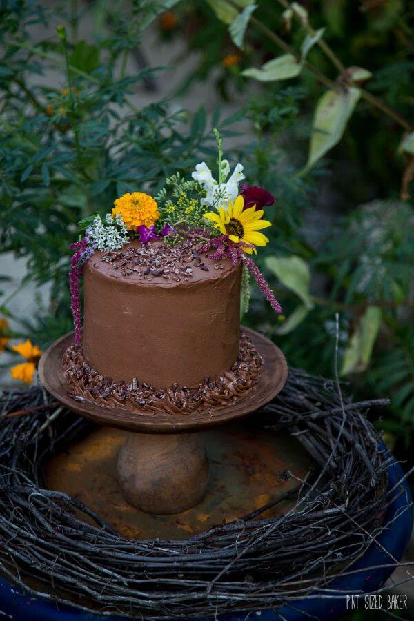 A stunning 4-layer Chocolate Cake all dressed up and ready for your garden party. Covered in edible flowers and simply stunning.