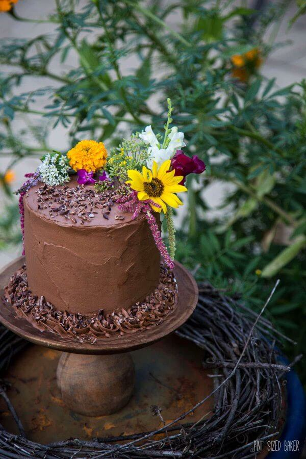 A rustic cake for an end of the summer garden party. 4 layer chocolate cake with cocoa nibs. Delicious!