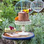 4 layer Chocolate Cake decorated with fresh picked edible flowers. The perfect dessert for the perfect day!
