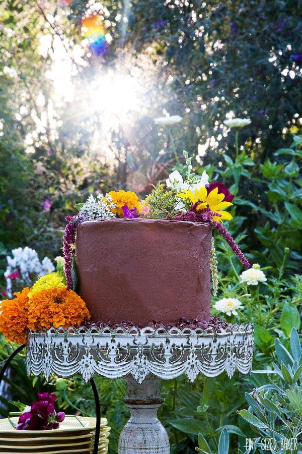 4-layer Chocolate Cake decorated with edible flowers for a pretty Garden Party Cake.