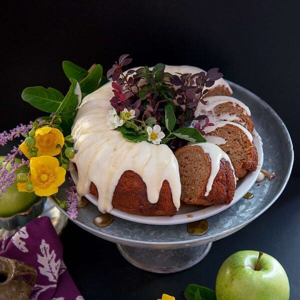 Slices of Apple Spice Bundt Cake are calling to be baked this fall season.