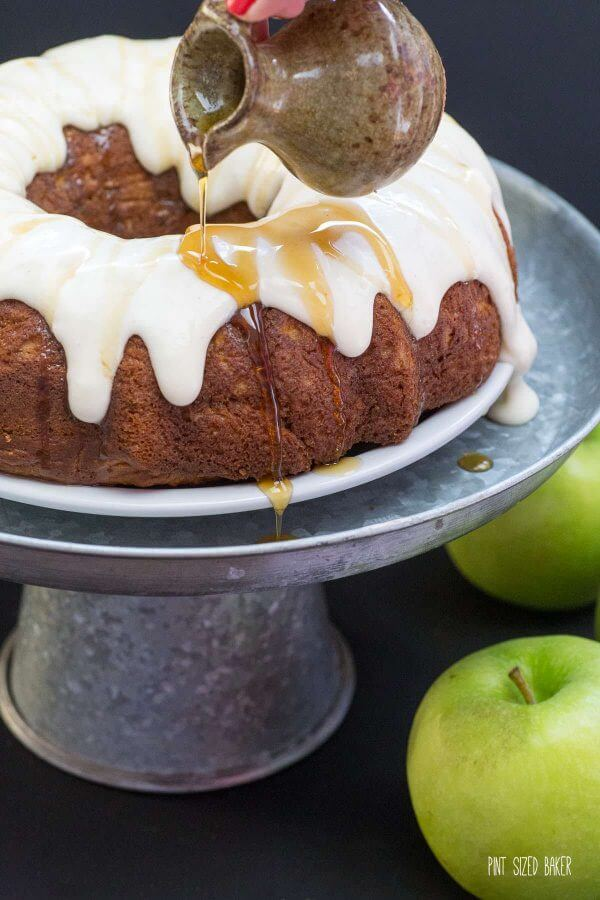 Dig into this Apple Spice Bundt Cake with decadent cream cheese frosting and a drizzle of maple syrup .