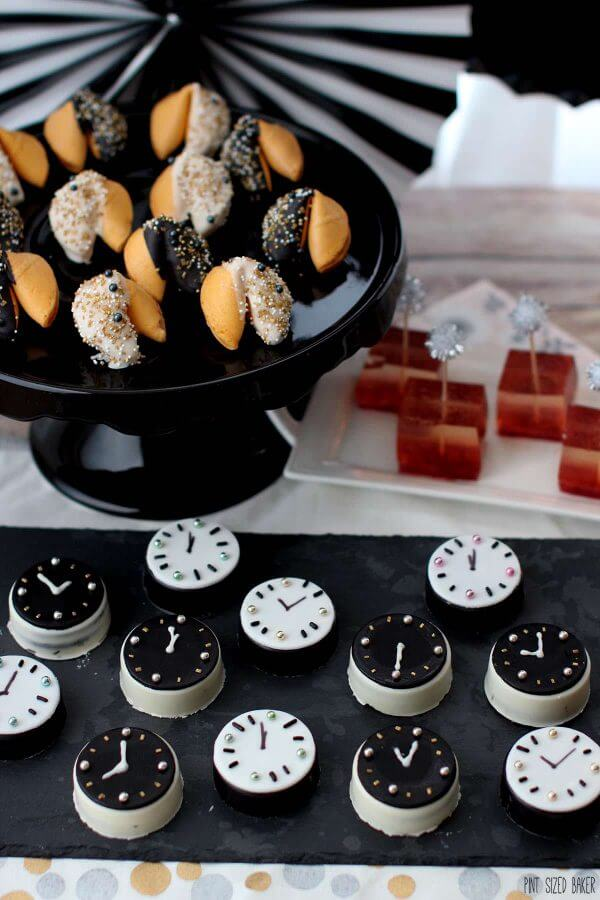It's a No Bake dessert table that fun for everyone! Fortune Cookies, Oreo Cookie Clocks and Strawberry Champagne Jello shots!