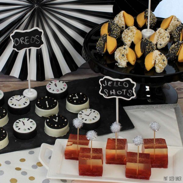 Ring in a New Year with a no-fuss, no-bake dessert table with Fortune Cookies, Oreo Cookie Clocks and Strawberry Champagne Jello shots!
