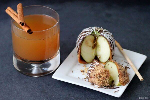 Cut into this Chocolate Covered Caramel Apple while sipping on some hot mulled cider.