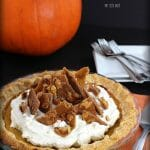 Thanksgiving Pumpkin Pie made with real, homemade pumpkin puree and topped with whipped cream and toffee shards.