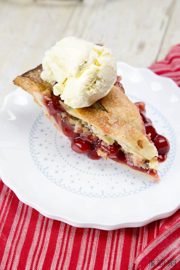 This Cherry Berry Pie is packed full of cherries and raspberries and is great when served with s a scoop of ice cream!