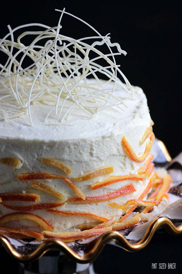 Dress up a cake with some sugared lemon and orange peels and some fun chocolate candy decorations.