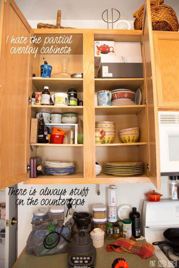 Beginning a Kitchen Renovation Project. Clutter in the cabinets and on the counter tops.