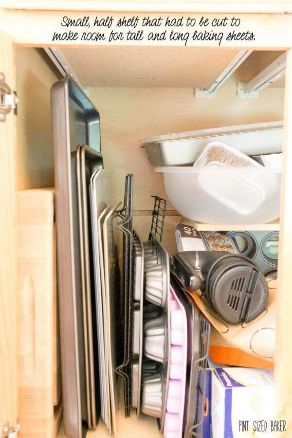 Kitchen cabinets that are just not organized and don't fit my baking dishes.