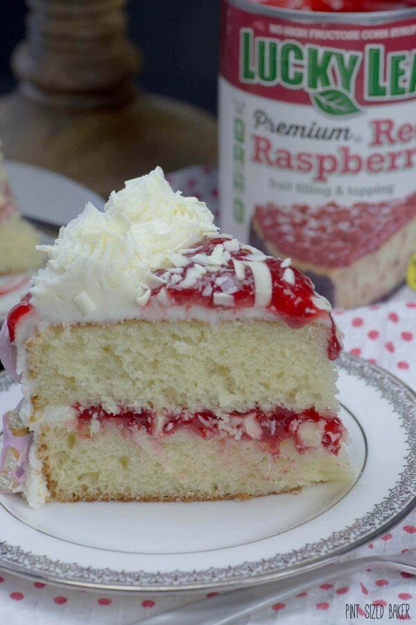 So stunning! This White Chocolate Raspberry Cake is made easy with a cake mix and @LuckyLeaf raspberry pie filling.