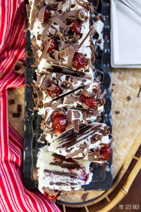 Slice into this No Bake Eclair Cake and you'll find layers and layers of chocolate graham crackers, white chocolate pudding and cherries! It's the ultimate no bake dessert!