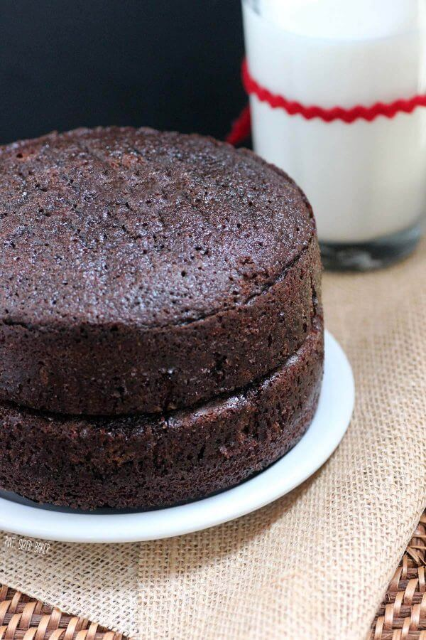 """Simple yet decadent Chocolate Cake Recipe that is the perfect base for many different buttercream frostings. Makes two 9"""" cakes that are great for stacking."""