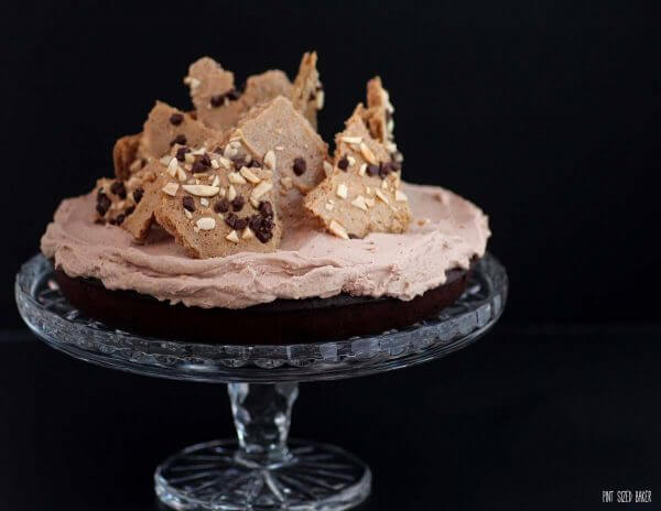 This gluten free chocolate flourless cake is a dense and rich cake covered in whipped cream and topped with mocha meringue bark.
