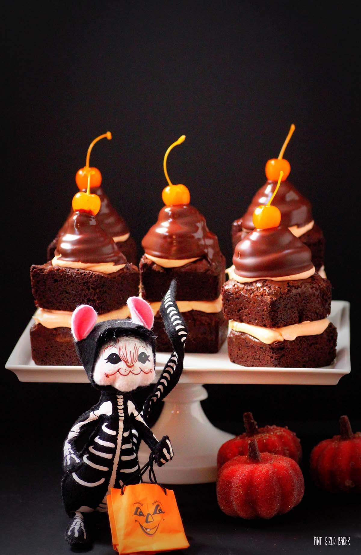 Layered brownies with marshmallow fluff frosting and dipped into chocolate. These High Hat Brownies are sure to please your sweet tooth.