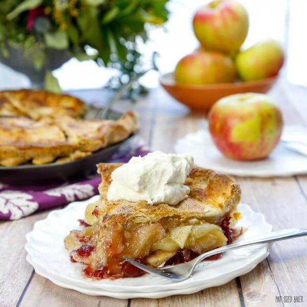 This Homemade Cranberry Apple Pie is made with fresh fruit and has half the sugar of a traditional cran-apple pie. It's bursting with flavor!