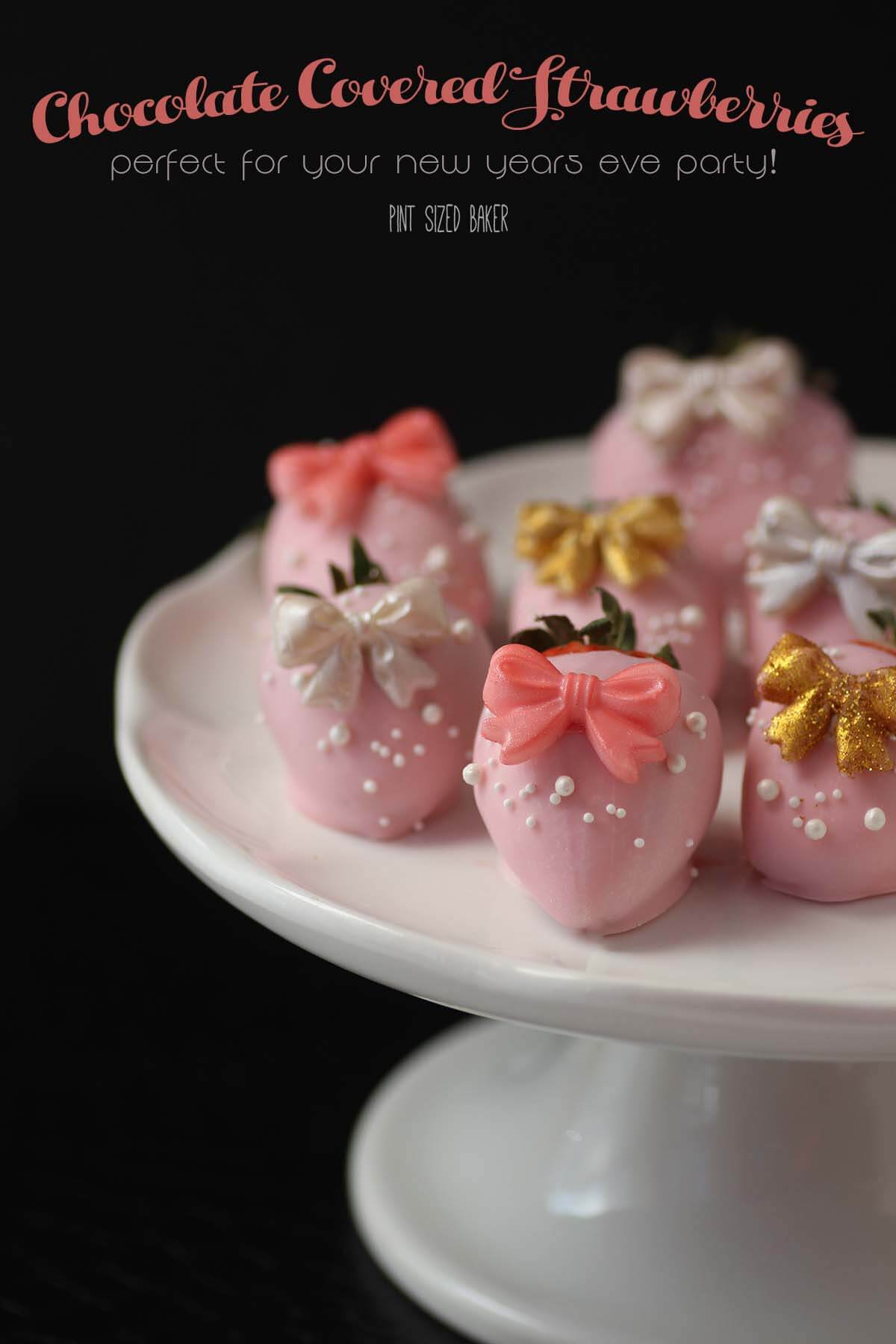 Pink Chocolate Covered Strawberries with pretty bows on. All dressed up for a thrilling New Years Eve or a fun Great Gatsby Party.