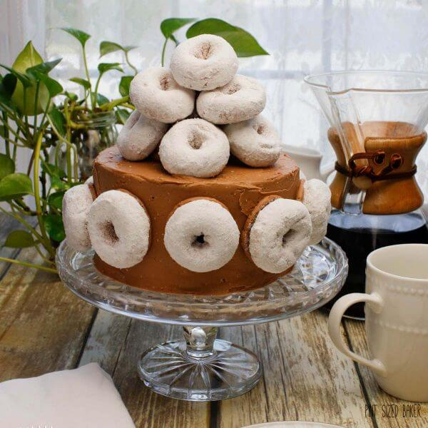 This Coffee and Donuts Cake is Homer Simpson approved! It's loaded with coffee flavor and covered with powdered sugar doughnuts. Yum!