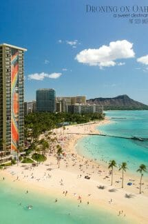 The Hilton Hawaiian Village with its iconic Rainbow Tower overlooks Waikiki with Diamond Head in the background. Droning in Hawaii