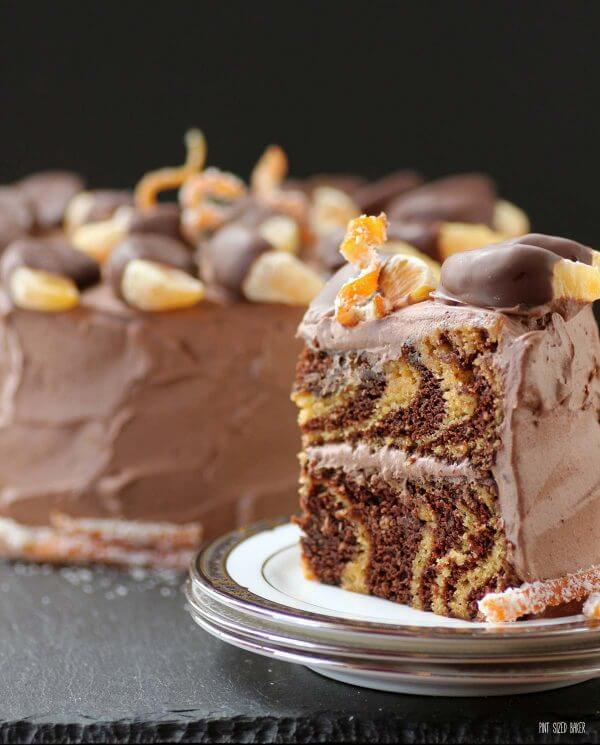 An image showcasing the zebra pattern on the inside of this Orange and Chocolate Cake! It's so cool to slice into and serve!