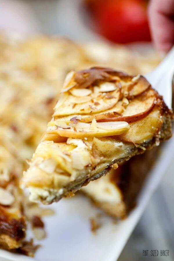 This quick and easy Almond Apple Cheesecake Recipe is going to be your new favorite treat. It combines sweet cinnamon apples with cheesecake that is perfect some caramel sauce.