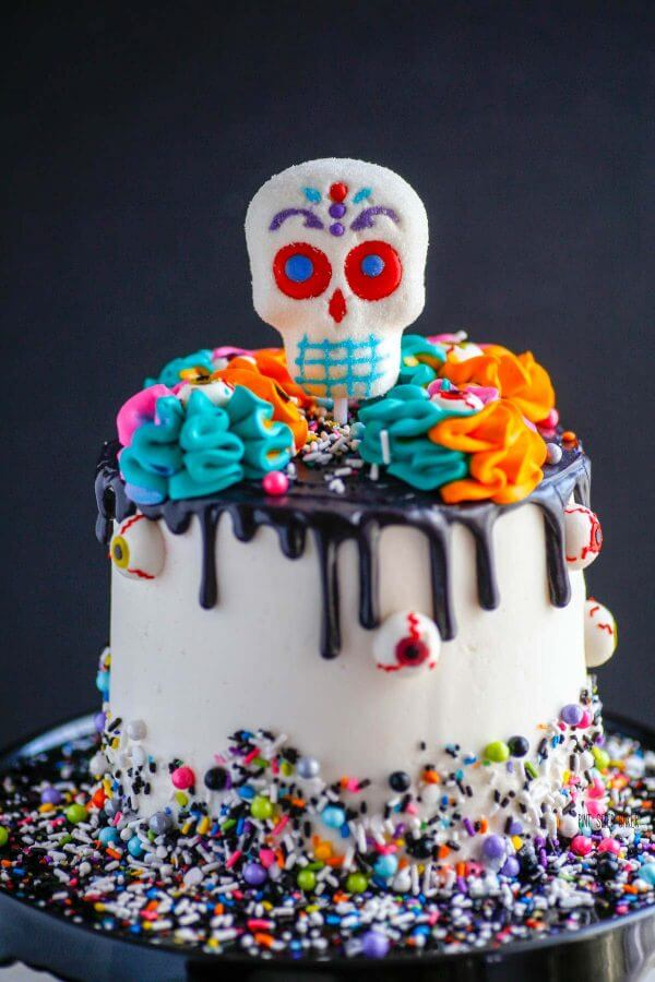 This Day of the Day Cake is perfect to serve up as a celebration of life of your past loved ones. I'd return from the dead for a slice of this colorful cake.