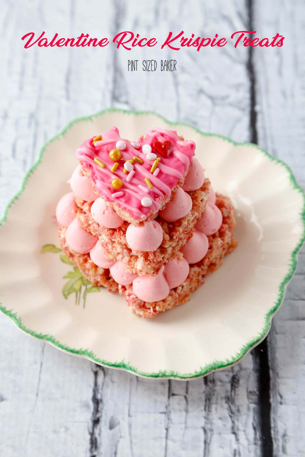 Everybody loves pink food! These Strawberry Valentine Rice Krispie Treats are made with pink Rice Krispie Cereal and strawberry pink frosting!