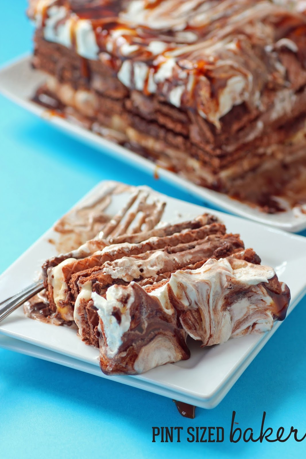 A chocolate wafer icebox cake on a blue background