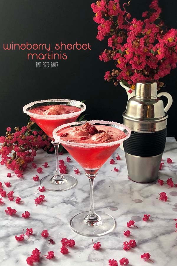 Wineberry Sorbet Martinis on a table with pink flowers.
