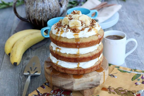 Horizontal image of finished banana cake. This naked cake is caramel sauce covered and delicious!