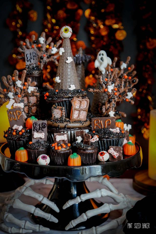 an image of a Haunted house cupcake tower decorated for Halloween
