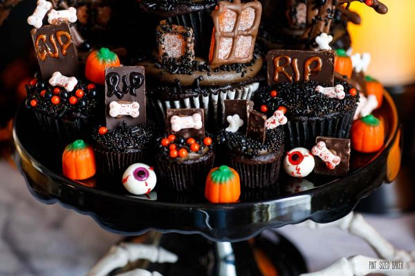 Candy pumpkins and gummy eyeballs with mini cupcakes for Halloween