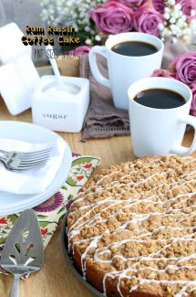 The key to this moist coffee cake are the rum soaked raisins and sour cream. The cinnamon crumb topping and icing burst with flavor.