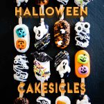 16 Caramel and Chocolate filled Cakesicles all decorated for Halloween!