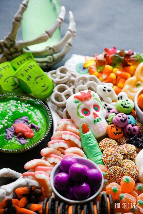 Purple gumballs, orange pumpkin candies, marshmallow candy, gummy teeth.