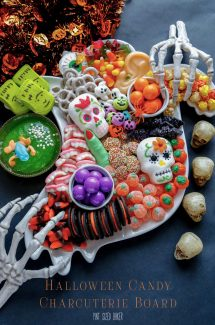 A Halloween Candy Ghost Charcuterie Board covered in fun Halloween treats.