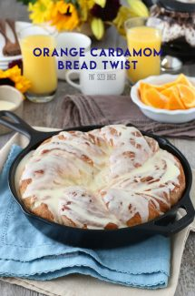 Orange bread finished and ready to be eaten on a table set for breakfast.