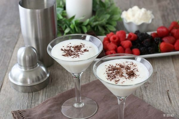 A horizontal view of the white martini recipe finished, topped with shaved chocolate, and ready to be enjoyed.