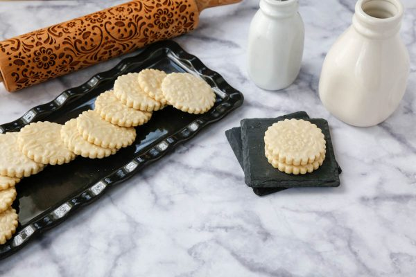 A horizontal image of the shortbread cookies on a black platter