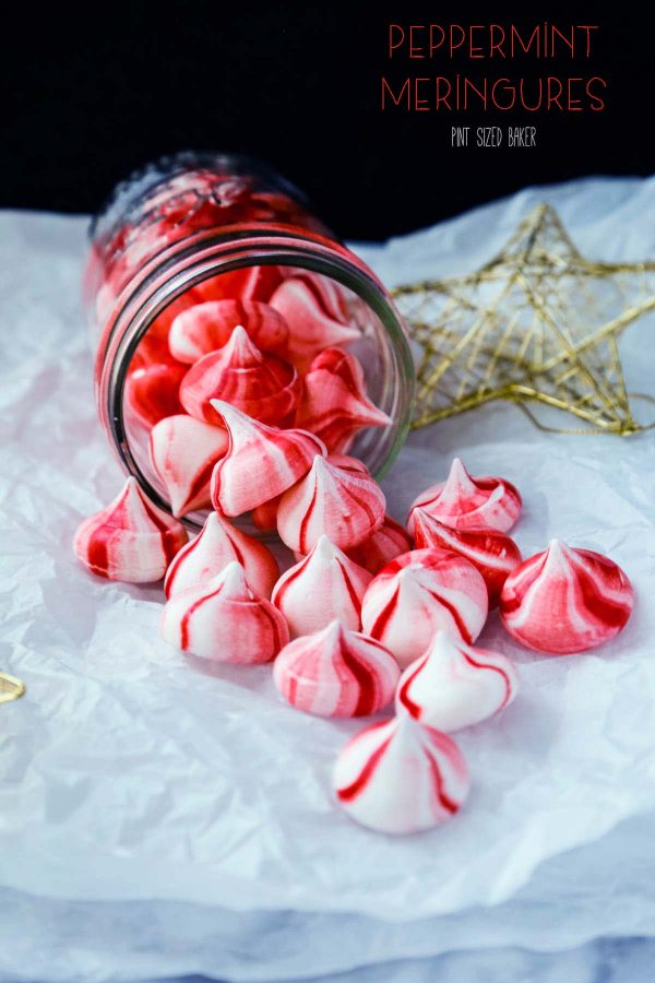 Lead-in image of red and white peppermint meringue cookies pouring out of a jar.