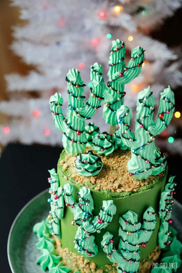 A top view of the meringue cacti with a white Christmas tree in the background.