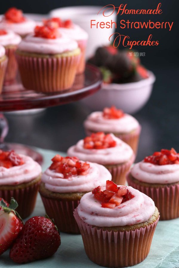 An image of strawberry cupcakes with fresh, diced strawberries on top.