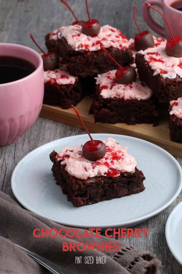 Homemade Fudgy brownies with maraschino cherry frosting and a chocolate dipped cherry on top.