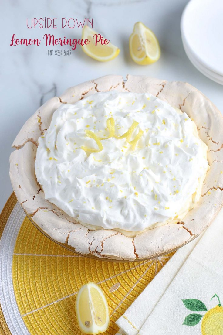 This upside down Lemon Cream Meringue Pie has the meringue on the bottom as the shell and then it's filled with sweet lemon curd and fresh whipped cream!
