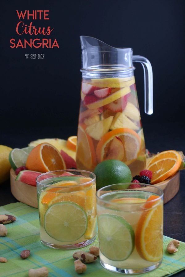 Enjoy this fruity and delicious Citrus White Wine Sangria right from the comfort of your own home. It's also a great adult beverage to make when you're hosting.