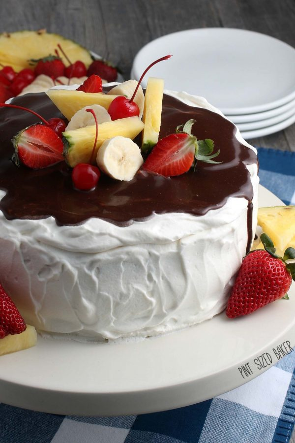 Another view that shows the finished recipe for banana split cake topped with fruit.