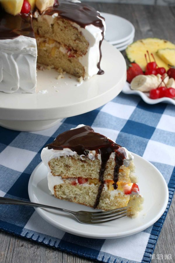 This photo shows a slice of the banana split dessert recipe on a plate ready to eat!