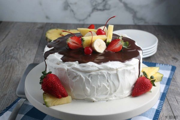 A horizontal image showing the recipe for banana split cake finished and ready to be devoured.