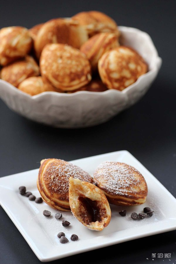 An image showing the inside of the Aebleskiver stuffed with a mini chocolate peanut butter cup.